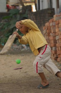 Time for a cricket break near a Compassion center in India.