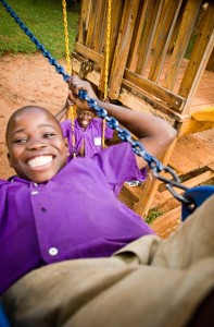 Just swinging away near a Compassion center in Uganda.